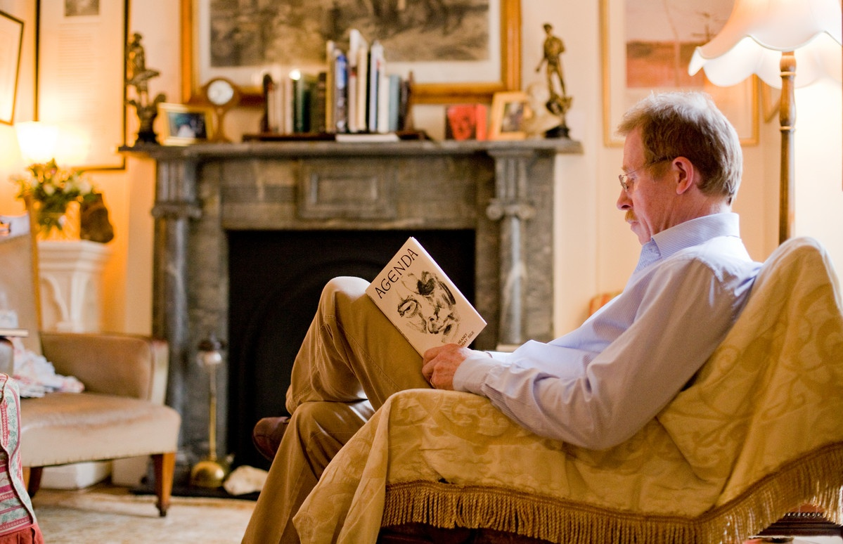 Eugene relaxes in the the sitting room at Laurel Villa reading a book